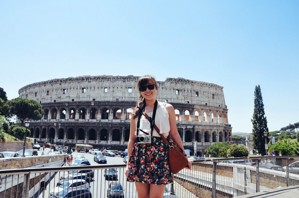 Girl standing in front of the Colosseum for a Picture in Rome