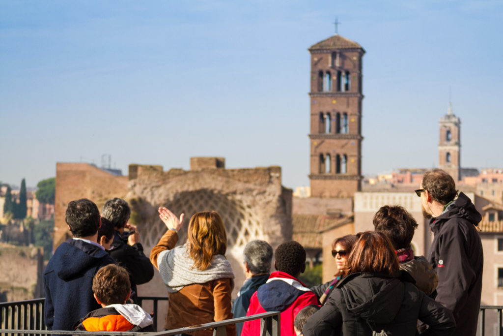 Guide with a group in the third Ring of the Colosseum